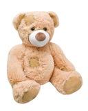 坐的斜向一边的玩具熊 库存图片