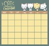 坐的猫日历 免版税图库摄影