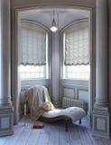 坐维多利亚女王时代的读书空间的典雅式样 库存照片