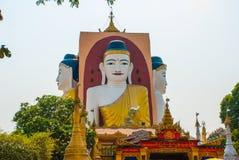 坐Buddhas四个雕象  塔Kyaikpun菩萨 Bago,缅甸 缅甸 库存图片