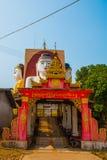 坐Buddhas四个雕象  塔Kyaikpun菩萨 Bago,缅甸 缅甸 图库摄影