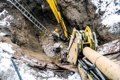 坑挖掘机的发展 免版税库存照片