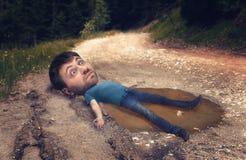 水坑的人 免版税库存照片