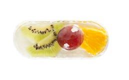 结块与猕猴桃、桔子和葡萄软糖,顶视图 库存图片