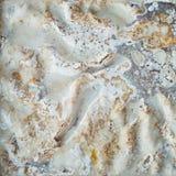 结块与被鞭打的奶油色结霜,油脂,肥胖洗涤剂溶化的油脂 免版税库存照片