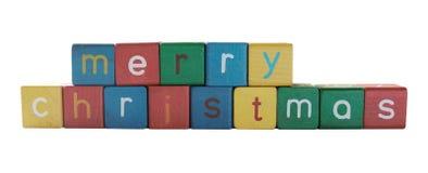 块儿童圣诞节在快活的s上写字 免版税库存照片