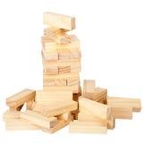 块崩溃了木的塔 库存图片