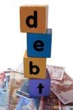 块现金负债在作用玩具上写字 免版税库存图片