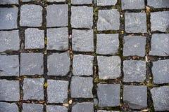 块路面在地板上的正方形石头 图库摄影