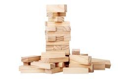 块崩溃了木的塔 库存照片