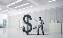 坚定的银行家人以现代办公室内部打破的美元 免版税库存图片
