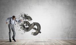 坚定的银行家人在打破美元形象的空的具体室 免版税图库摄影