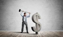 坚定的银行家人在打破美元形象的空的具体室 免版税库存图片