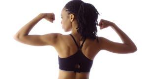 坚强的非洲妇女背面图  免版税图库摄影