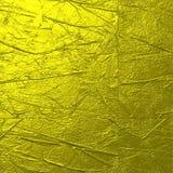 坚硬金子被弄皱的纹理背景 免版税库存图片