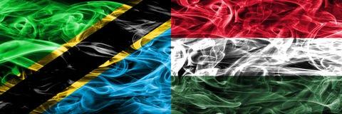 坦桑尼亚对匈牙利,肩并肩被安置的匈牙利烟旗子 坦桑尼亚和匈牙利的厚实的色的柔滑的烟旗子, 皇族释放例证