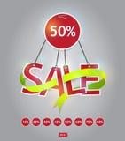 垂悬与绿色丝带的红色销售文本 免版税库存图片