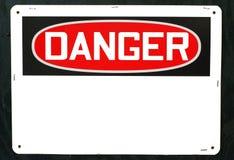 垂悬在墙壁上的普通危险标志 免版税图库摄影