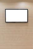 垂悬在墙壁上的等离子电视 库存照片
