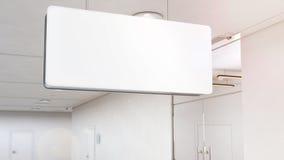 垂悬在天花板,裁减路线的空白的白光标志大模型 免版税库存照片