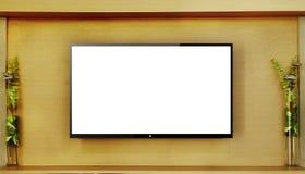 垂悬在木墙壁上的被带领的电视 免版税库存照片