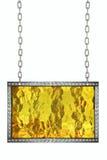 垂悬在链子的发光的金银铜合金牌被隔绝 图库摄影