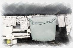 垂悬在风的衣裳在一个白色村庄在亚得里亚海的Salento 库存图片