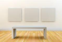 垂悬在画廊白色墙壁上的3块空白的帆布 图库摄影