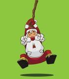 垂悬在绳索的圣诞老人 免版税库存照片