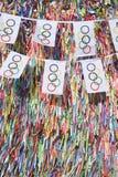 垂悬在巴西愿望丝带前面的奥林匹克旗子旗布 库存图片