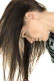 垂悬妇女接近的顶头的头发下来 库存图片