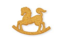 垂悬的一件金黄摇马圣诞节装饰品在克里斯 库存照片