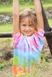 垂悬的小女孩 库存照片