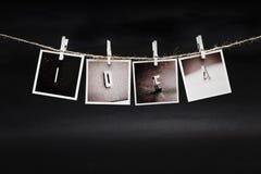 垂悬的照片 免版税库存图片