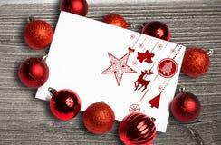 垂悬红色圣诞节装饰的综合图象 免版税库存图片