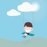 垂悬从云彩的摇摆的小男孩 免版税图库摄影