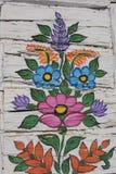 垂直被绘的花的主题 免版税库存照片