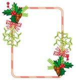 垂直的框架用霍莉莓果,杉木锥体,鞠躬 库存照片
