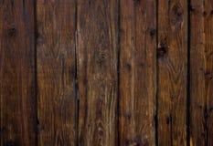 垂直的老黑褐色木板条背景 免版税库存图片