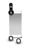 垂直站立与在照片摄象机镜头的夹子的手机 免版税库存图片