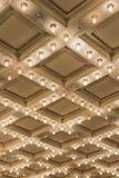垂直老剧院大门罩的云幂灯 图库摄影