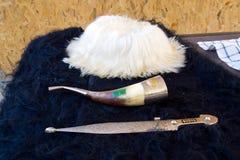 垫铁,匕首和papakha民族文化Adyghe对象  免版税图库摄影