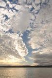 埃克斯默思,德文郡:低潮、海滩和日落 Cloudscape天际 库存图片