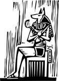 埃及坐的Anubis 免版税库存照片