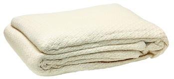 100%埃及棉花被折叠的旅馆毯子 免版税图库摄影