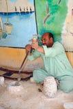 埃及艺术家做与简单的美好的对象意味 图库摄影