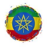 埃塞俄比亚的圆的难看的东西旗子与在旗子颜色飞溅 皇族释放例证