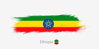 埃塞俄比亚的旗子,在灰色背景的难看的东西抽象刷子冲程 库存例证