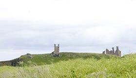 城堡dunstanburgh 库存图片