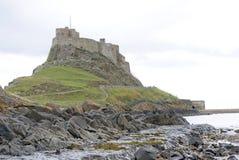 城堡lindisfarne 库存图片